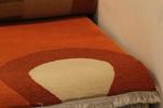 Ръчно изработени килими Файн Непал в бежево-кафявата, оранжевата, червената и зелената гама